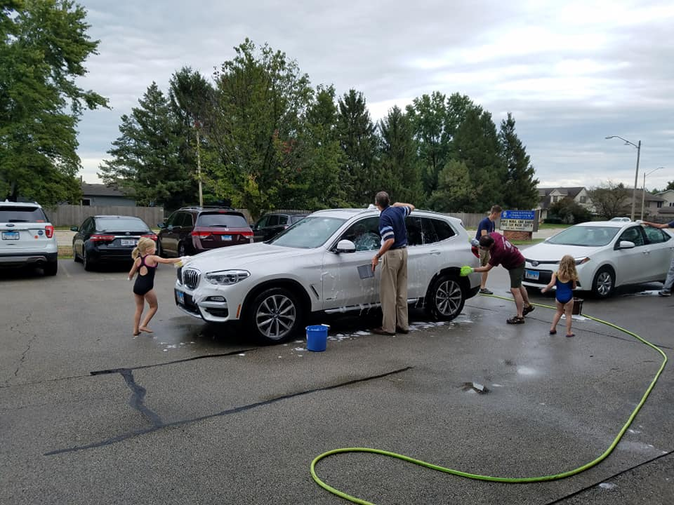 People washing a car